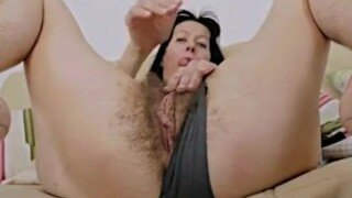 Skinny brunette milf films herself stripping naked. She does not stop there she also fingers and touches her tits till she is satisfied.