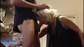 An amateur milf gives a milf blowjob to her plumber who is an amateur where the milf seduces her work in her kitchen until the plumber fucks.