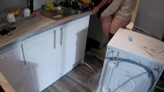 An amateur wife in the kitchen is horny for the plumber so she fucks the worker as plumber fucks wife after the plumber is seduced in the kitchen.